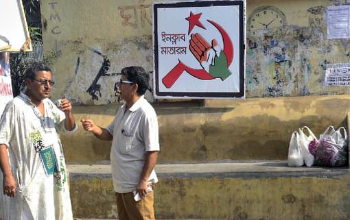 Convenient Partners a joint campaign poster for the CPM and Congress in Kolkata. the two rivals have forged a seat-sharing pact.