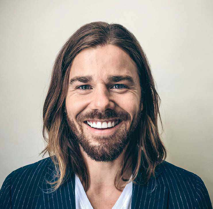 PRICE HIKE: THE PATH TO $70,000 Dan Price took a walk in the woods with a friend who was struggling to live on less than $50,000, about a million dollars below what he was making. Some two weeks later, he instituted his minimum wage of $70,000 and challenged other entrepreneurs to follow him.