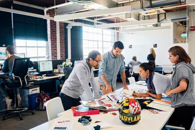 Under Armour team-sports designers, discussing concept for uniforms and performance gear theyre making for Planks alma mater the University of Maryland