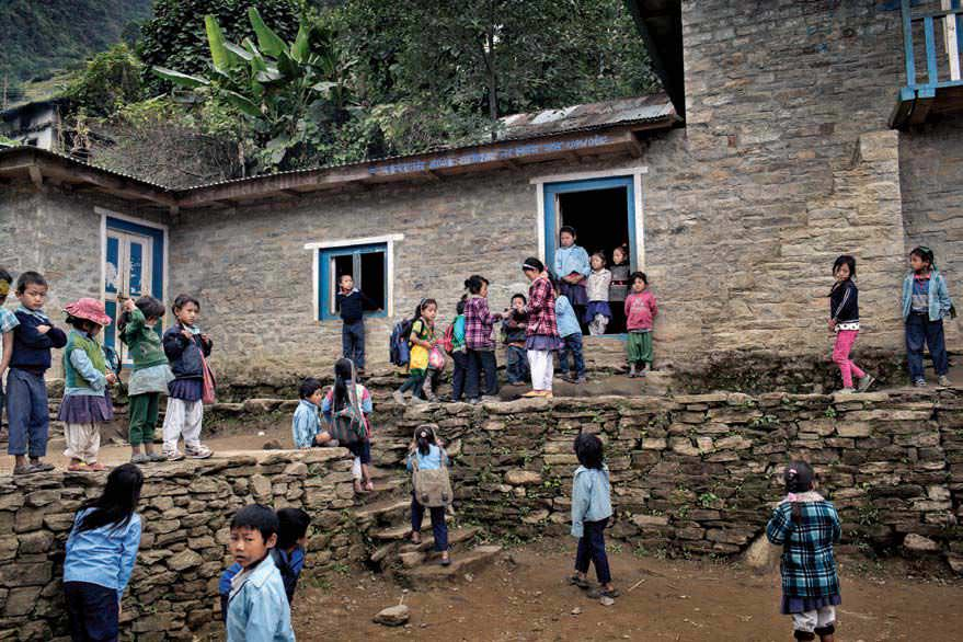 Nepali children play at Busuki Lower Secondary School in Tamua Village on Oct. 30. Dzi is retrofitting the school, which was damaged by aftershocks in May.