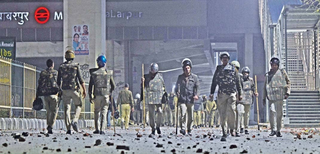 Cops Fire Tear Gas As 2 Groups Clash Over CAA