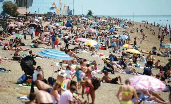 Beaches Packed As Furloughed Join Crowds Enjoying Heatwave