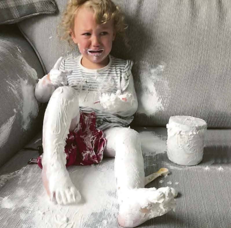 No Wriggling Out Of This... Tot Covers Herself In Cream