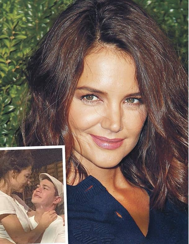 KATIE COOKS UP ROMANCE WITH HUNKY CHEF, 33!
