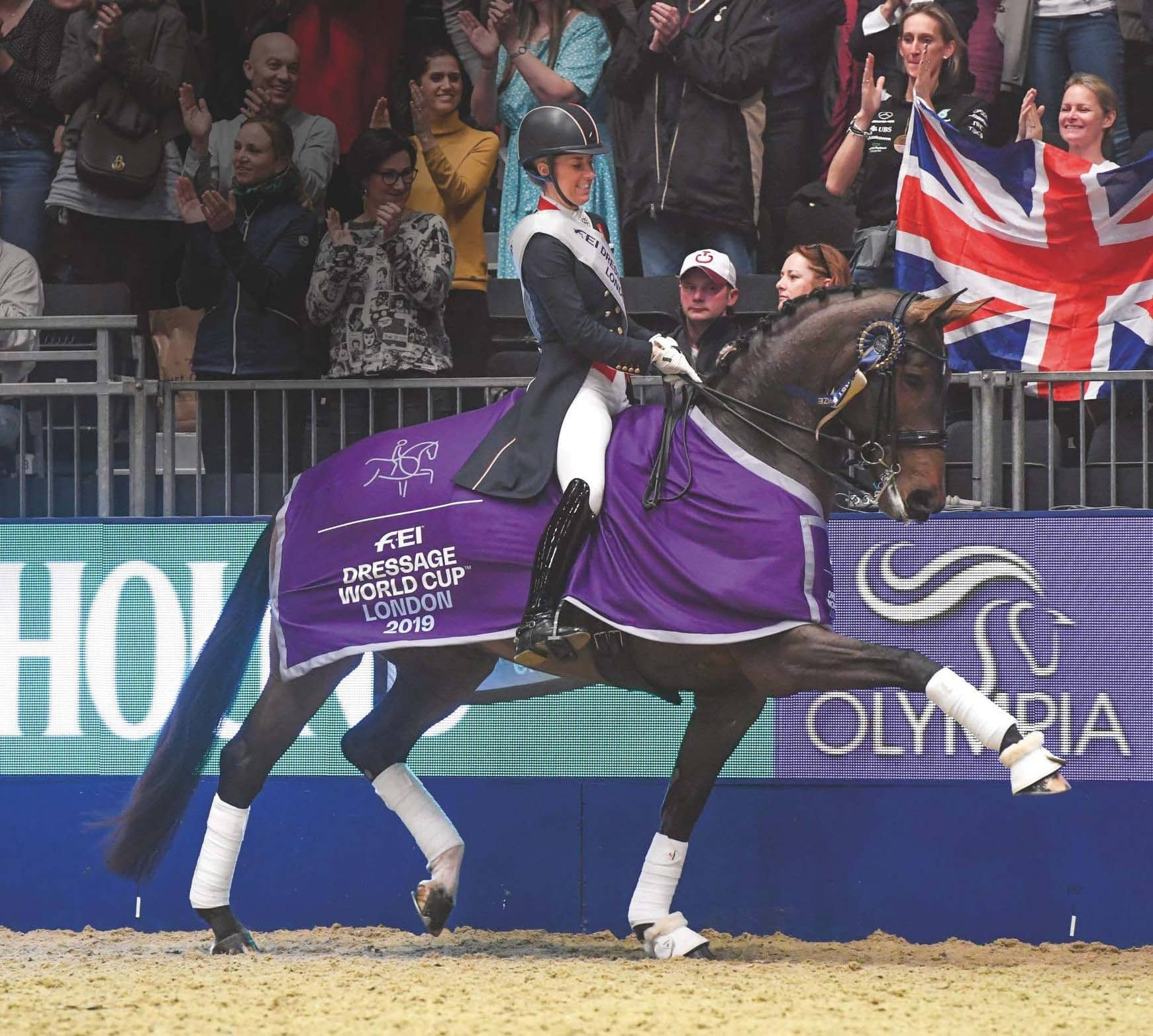Dujardin Reclaims Her Crown