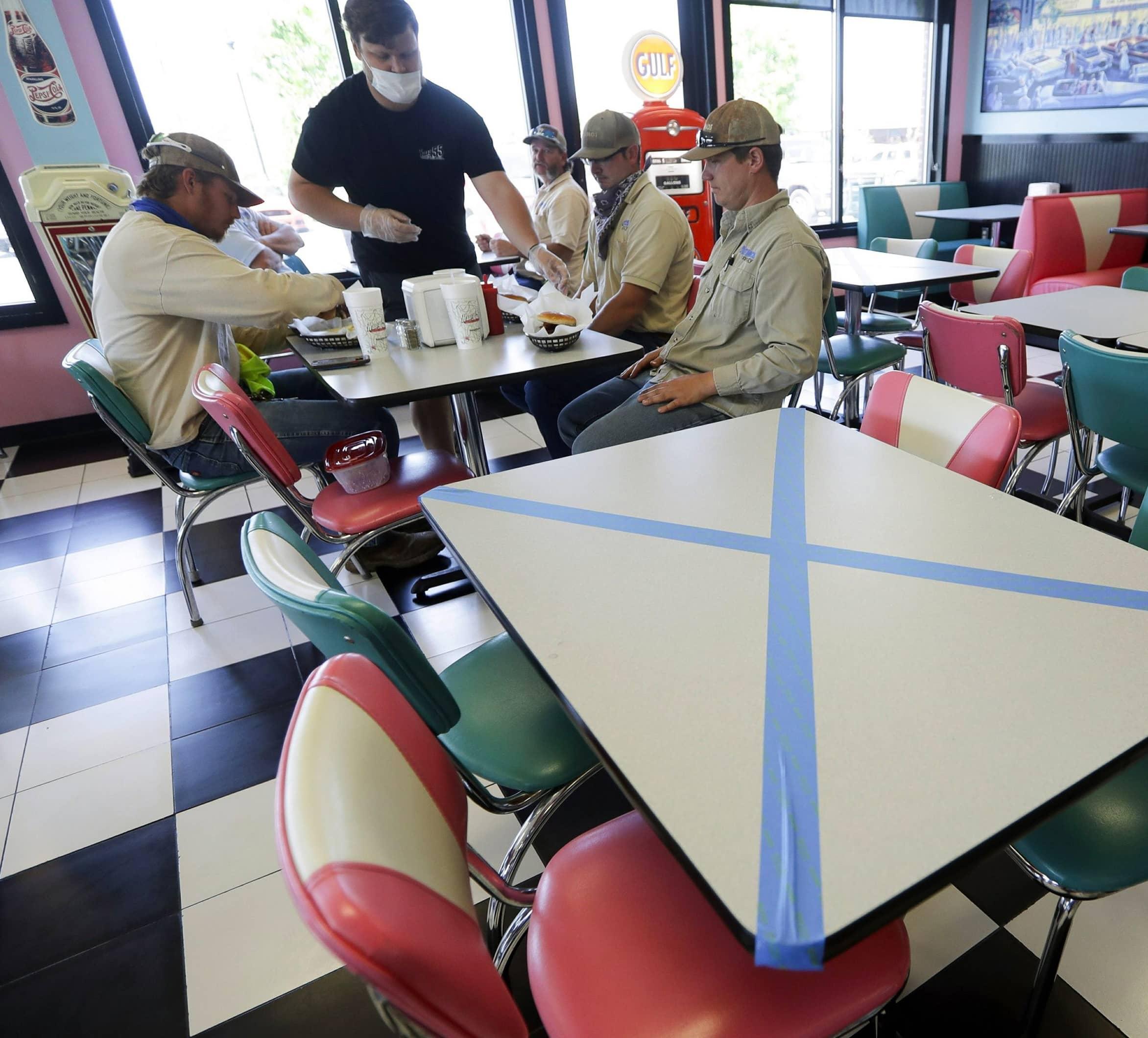 MASKS, TEMPERATURE CHECKS MARK 'NEW NORMAL' AT RESTAURANTS