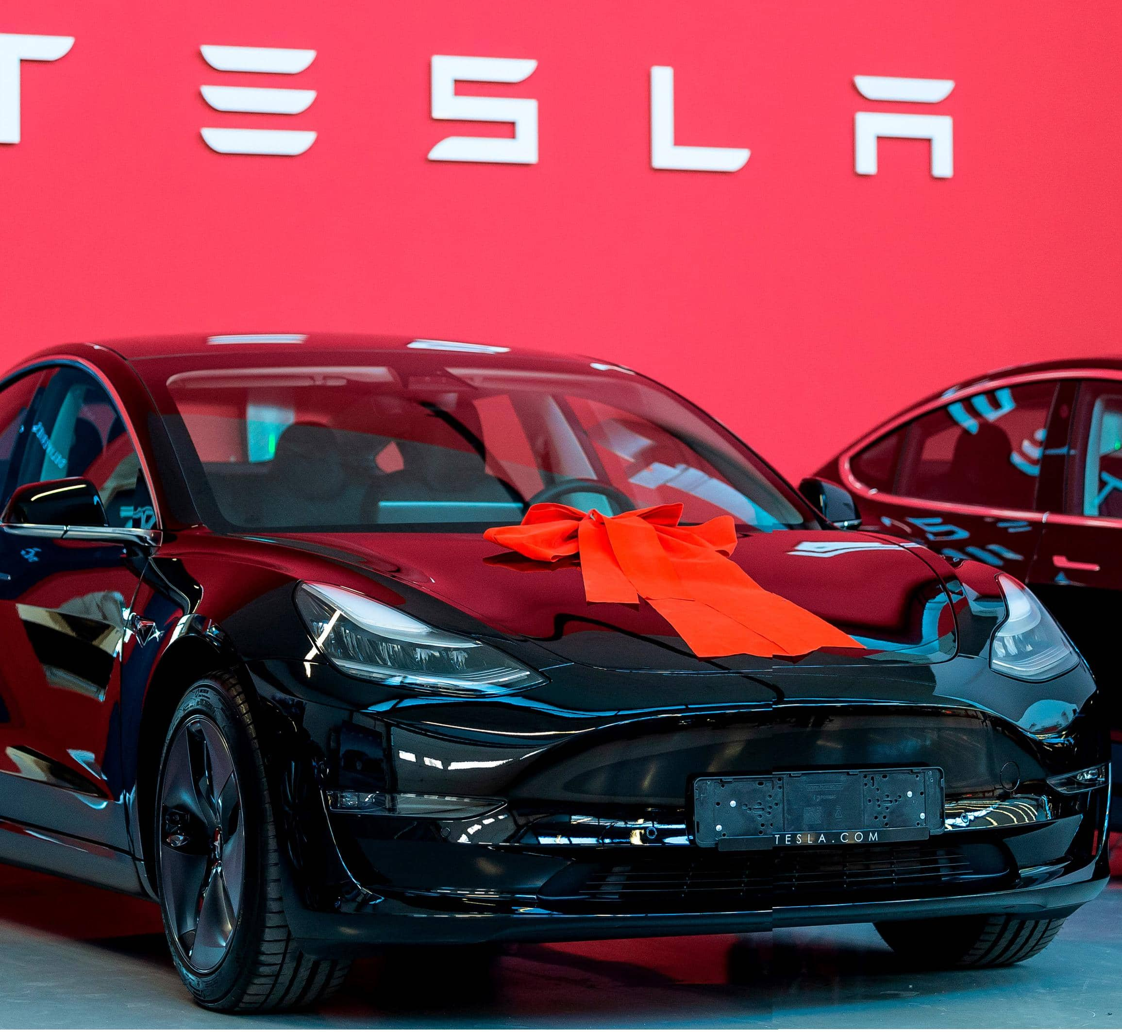TESLA AND APPLE BOOSTS TURBOCHARGED STOCK WITH PLAN FOR SPLIT