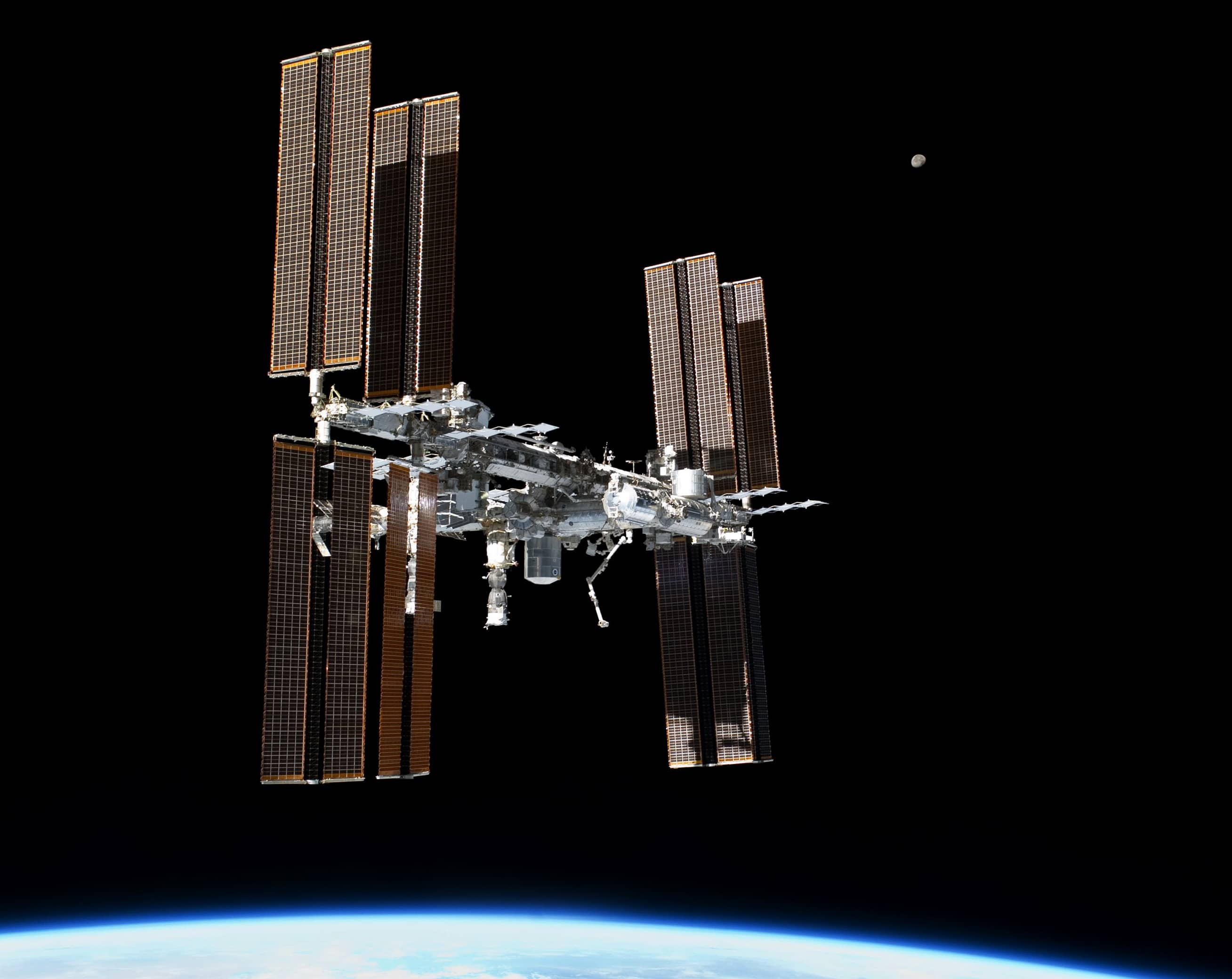 2 Russians Venture Into Open Space From Space Station