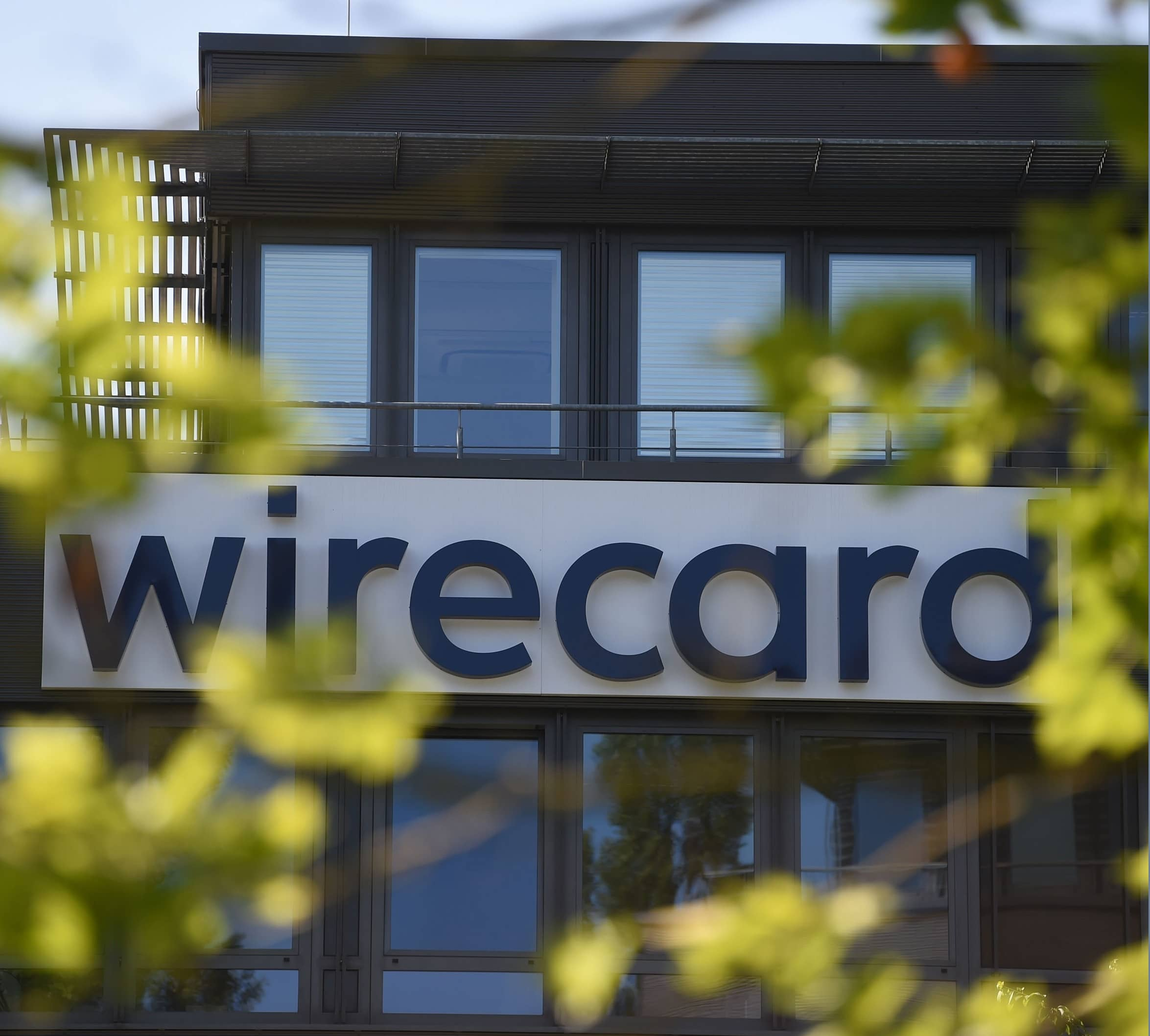 WIRECARD HEADQUARTERS RAIDED IN PROBE OF ACCOUNTING SCANDAL