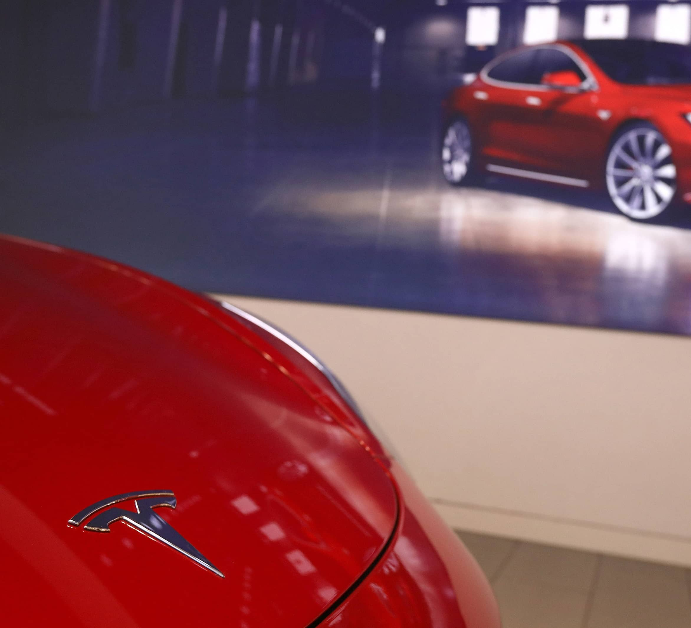 TESLA POSTS NET PROFIT FOR FIFTH STRAIGHT QUARTER