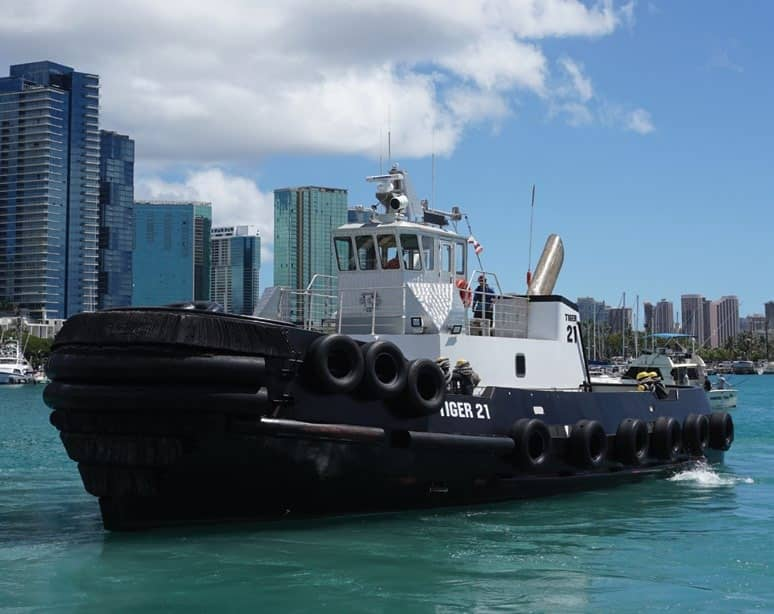 At Work Another day in paradise for agile island tug